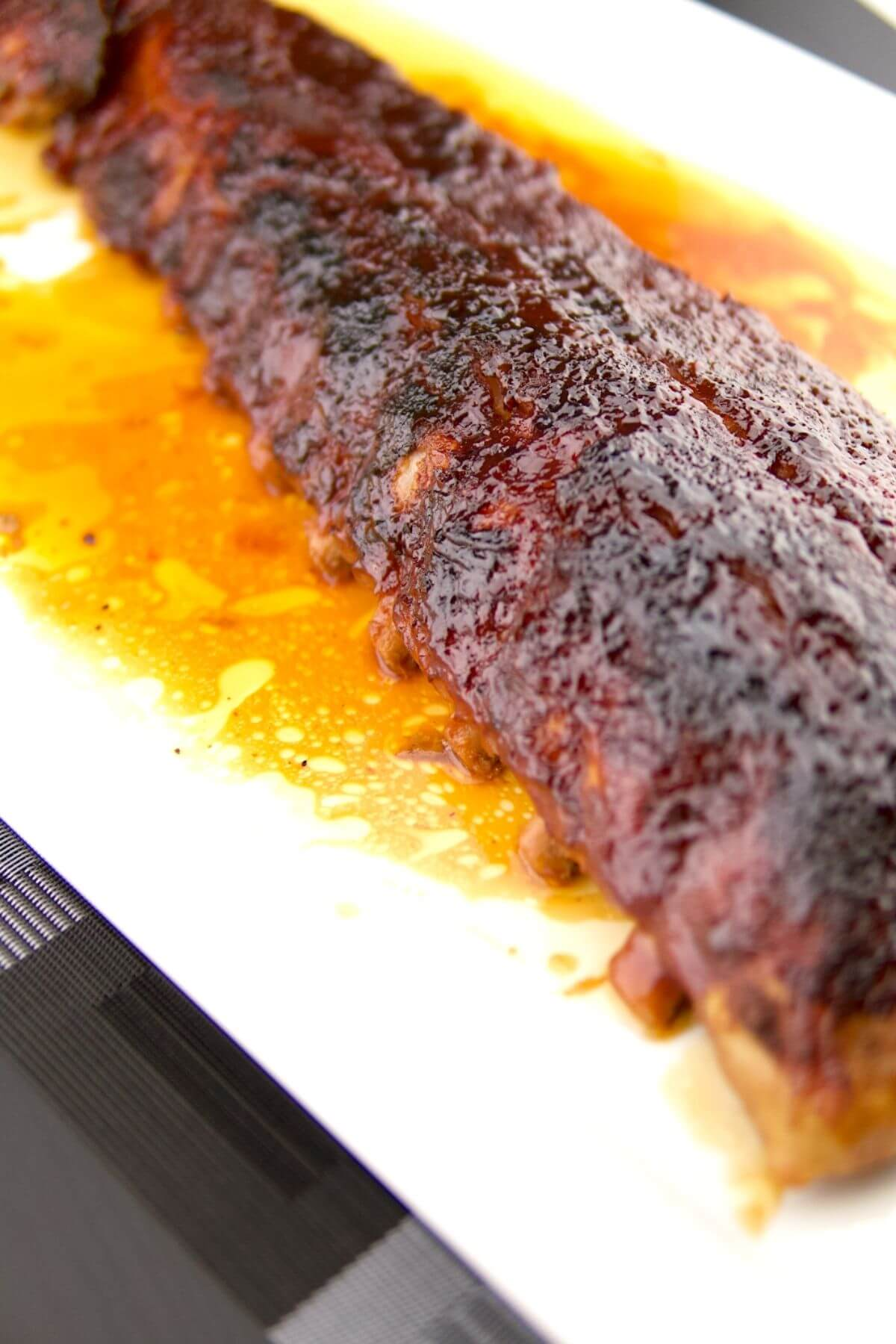 Saucy BBQ Fall Off The Bone Oven Baked Ribs 1 of 3